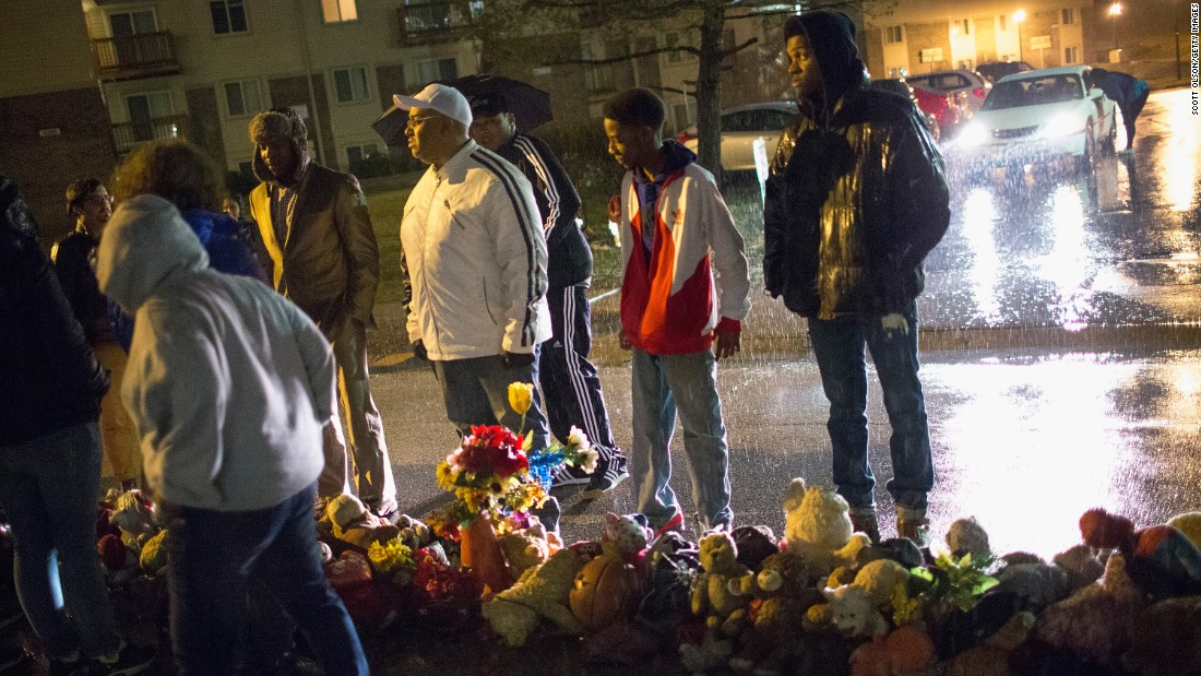Demonstrators visit a memorial to Michael Brown on Friday, March 13, in Ferguson, Missouri.