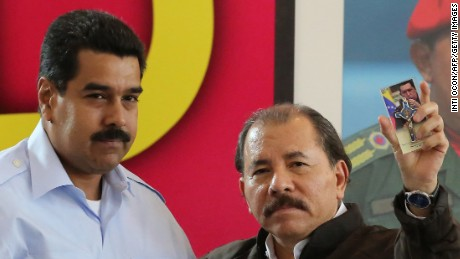 Nicaraguan President Daniel Ortega (R) is seen alongside his Venezuelan counterpart Nicolas Maduro during a Petrocaribe summit in Managua on June 29, 2013. AFP PHOTO / Inti OCON (Photo credit should read Inti Ocon/AFP/Getty Images)