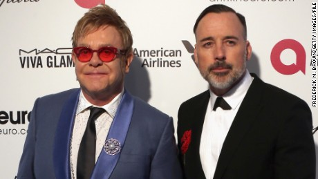 WEST HOLLYWOOD, CA - FEBRUARY 22: Sir Elton John (L) and David Furnish attend the 23rd Annual Elton John AIDS Foundation's Oscar Viewing Party on February 22, 2015 in West Hollywood, California. (Photo by Frederick M. Brown/Getty Images)
