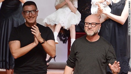 Stefano Gabbana and Domenico Dolce during the runway at the Dolce&Gabbana show during the Milan Fashion Week Autumn/Winter 2015 on March 1, 2015 in Milan, Italy.  (Photo by Pietro D'Aprano/Getty Images)