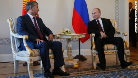 Russian President Vladimir Putin, right, and Kyrgyz President Almazbek Atambayev speak during their meeting in the Konstantin Palace outside St. Petersburg, Russia, Monday, March 16, 2015. Putin resurfaced Monday aftera 10-day absence from public view, looking healthy. (AP Photo/Anatoly Maltsev, Pool)