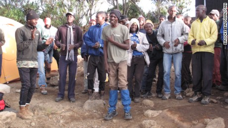 An army of porters keeps the heavy-breathing, sea-level dwellers laughing -- and breathing -- as they conquer Kilimanjaro.