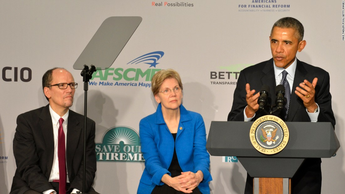President Barack Obama (right) speaks as Warren and Labor Secretary Tom Perez listen at an AARP conference, February 23, 2015 in Washington, D.C.