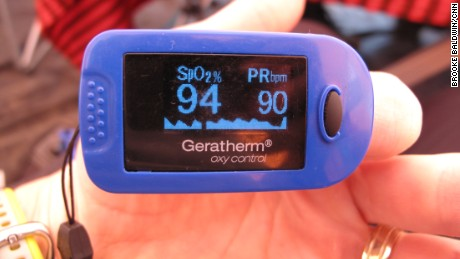 The climbers measure their heart rates and blood oxygen levels using oximeters on their fingers.