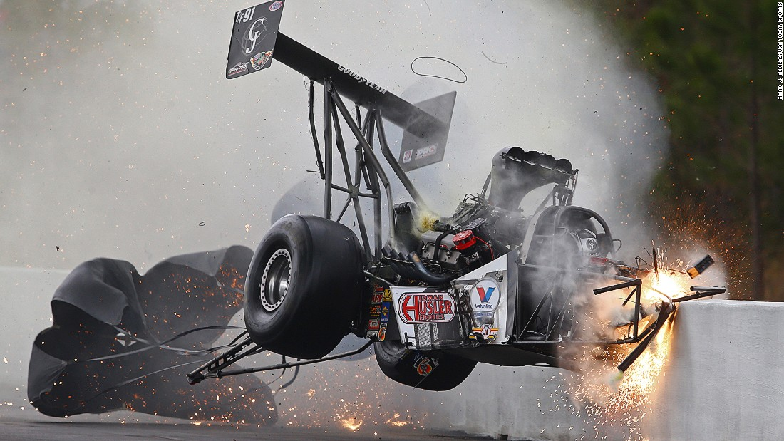 Drag racer Larry Dixon crashes into the wall during the Gatornationals event Saturday, March 14, in Gainesville, Florida. The car broke in half, but Dixon walked away from the incident.