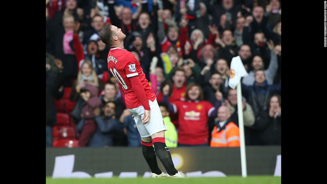 "Manchester United captain Wayne Rooney falls backward as he celebrates a goal Sunday, March 15, in Manchester, England. <a href=""http://www.cnn.com/2015/03/15/football/football-man-utd-tottenham-chelsea/"" target=""_blank"">Rooney was making light of a recent video</a> that showed him getting knocked down while playfully boxing in his home."