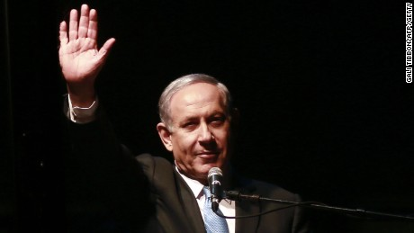 Caption:Israeli Prime Minister and Likud party's candidate running for general elections, Benjamin Netanyahu gestures to his supporters during a campaign rally on March 15, 2015, in Rabin Square in the Israeli costal city of Tel Aviv. Two days before Israel's election, Netanyahu make a last-ditch effort to garner support by appealing to the centre and heading for a mass rally in Tel Aviv. AFP PHOTO / GALI TIBBON (Photo credit should read GALI TIBBON/AFP/Getty Images)