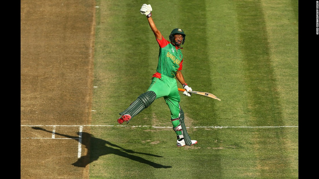 Bangladesh's Mahmudullah Riyad celebrates scoring a century during a Cricket World Cup match against New Zealand on Friday, March 13. New Zealand, one of the tournament's co-hosts, won the match by three wickets, but both teams advanced to the knockout stage.