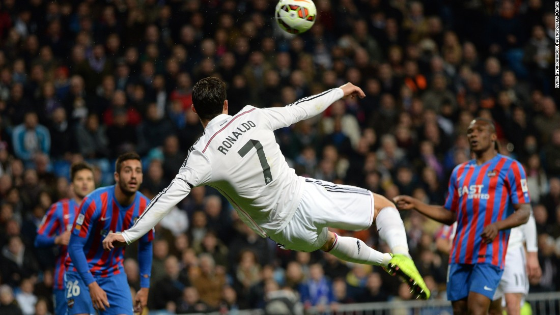 Real Madrid's Cristiano Ronaldo, the reigning World Player of the Year, turns his body to volley the ball Sunday, March 15, during a Spanish league match against Levante in Madrid.