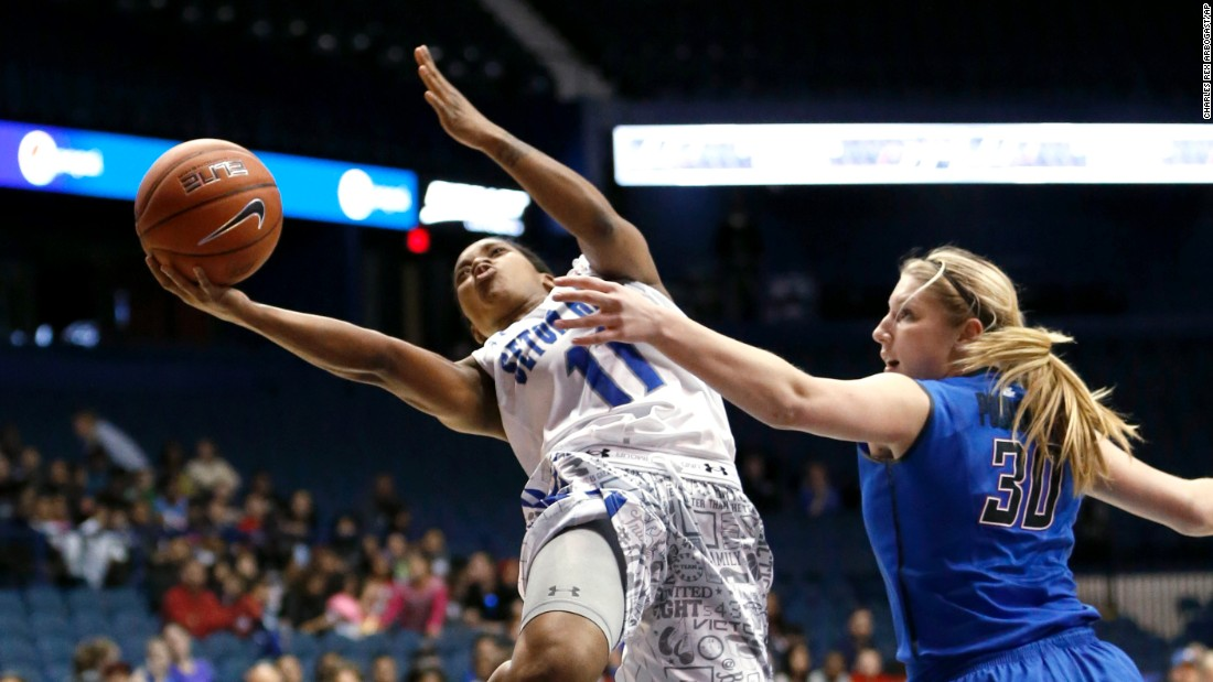 Seton Hall guard Ka-Deidre Simmons drives past DePaul forward Megan Podkowa during the final of the Big East tournament Tuesday, March 10, in Rosemont, Illinois. DePaul won the game 78-68.