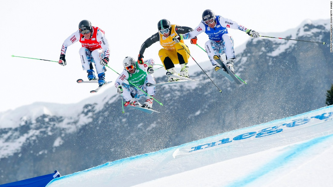 Freestyle skier Sylvain Miaillier, second from left, holds off the competition to win a World Cup ski-cross race in Megeve, France, on Friday, March 13.
