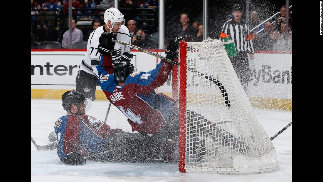Colorado teammates Jan Hejda, left, and Tyson Barrie crash into each other as they defend an empty net against Los Angeles' Jeff Carter on Tuesday, March 10.