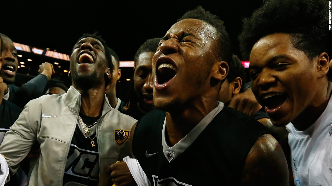 VCU basketball players celebrate Sunday, March 15, after they defeated Dayton to win the Atlantic 10 tournament in New York.