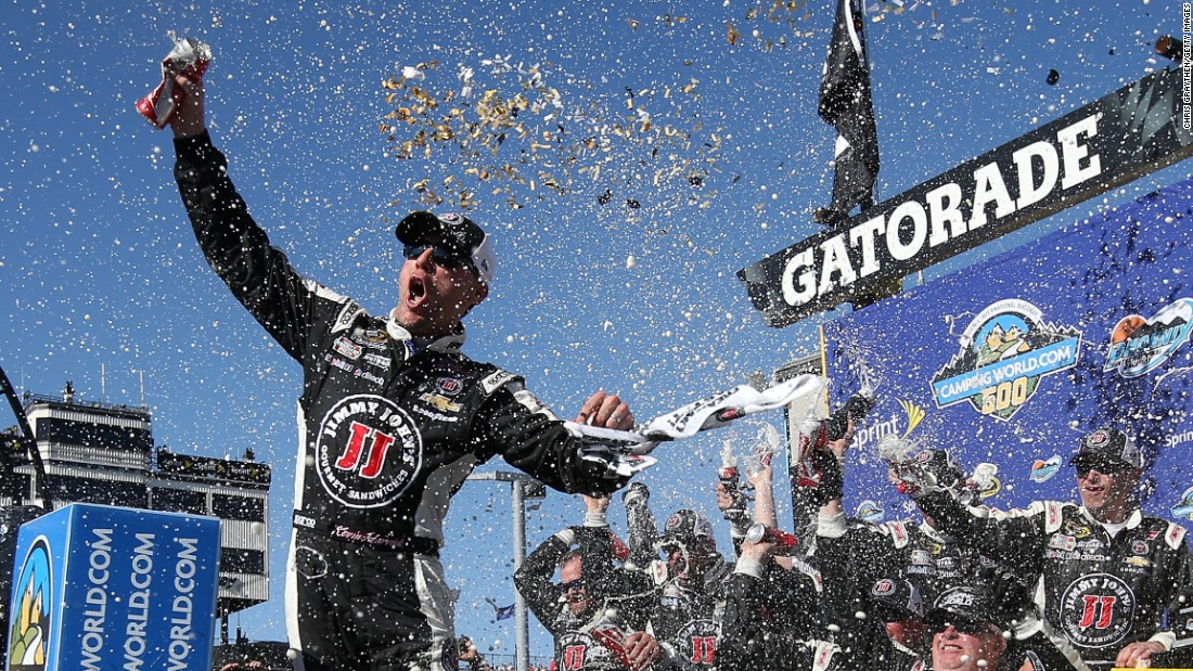 Confetti flies as NASCAR driver Kevin Harvick and his crew soak in a Sprint Cup victory Sunday, March 15, at Phoenix International Raceway.