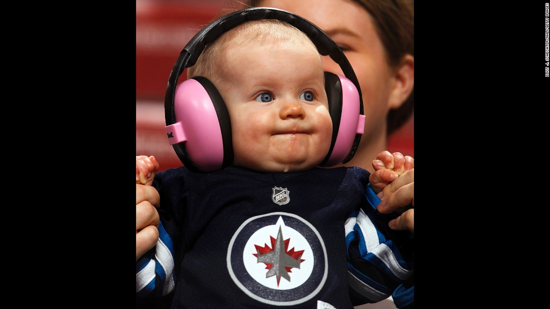 A young Winnipeg Jets fan watches the action during an NHL game in Sunrise, Florida, on Thursday, March 12.