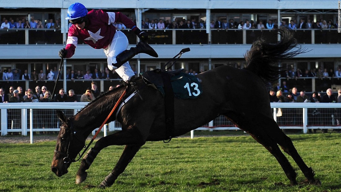 Johnny King falls off Thunder and Roses during a steeplechase race in Cheltenham, England, on Tuesday, March 10.