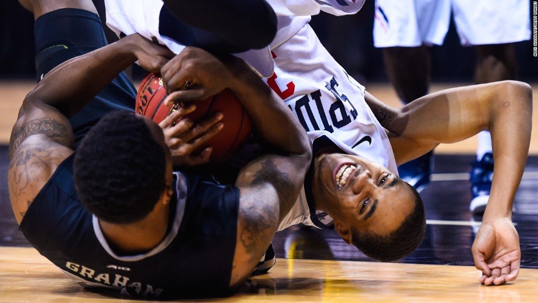 Richmond's ShawnDre' Jones, right, and VCU's Treveon Graham wrestle for the ball during an Atlantic 10 tournament game Friday, March 13, in New York.