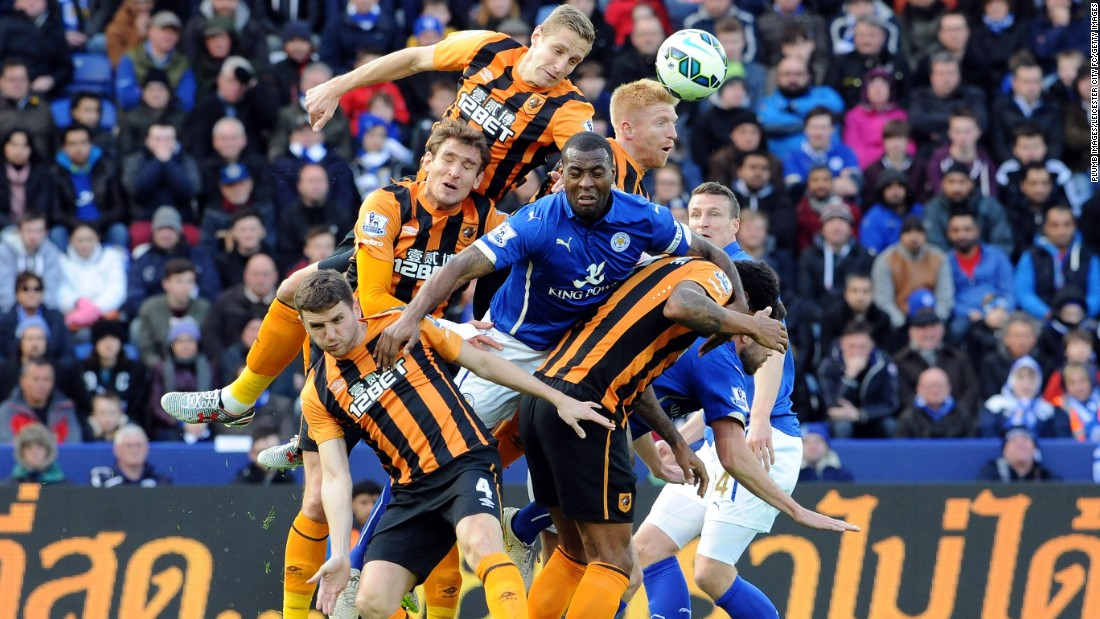 Players from Leicester City (blue) and Hull City compete for a header during a Premier League match in Leicester, England, on Saturday, March 14.