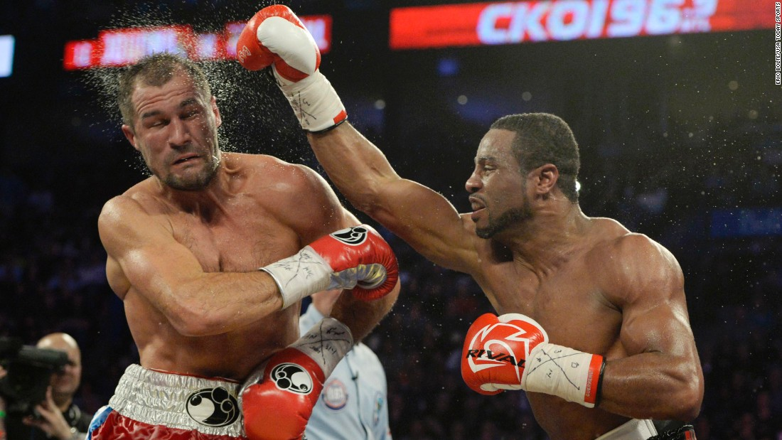 Jean Pascal punches Sergey Kovalev during their light-heavyweight title bout Saturday, March 14, in Montreal. But Kovalev retained his belts with an eighth-round TKO.