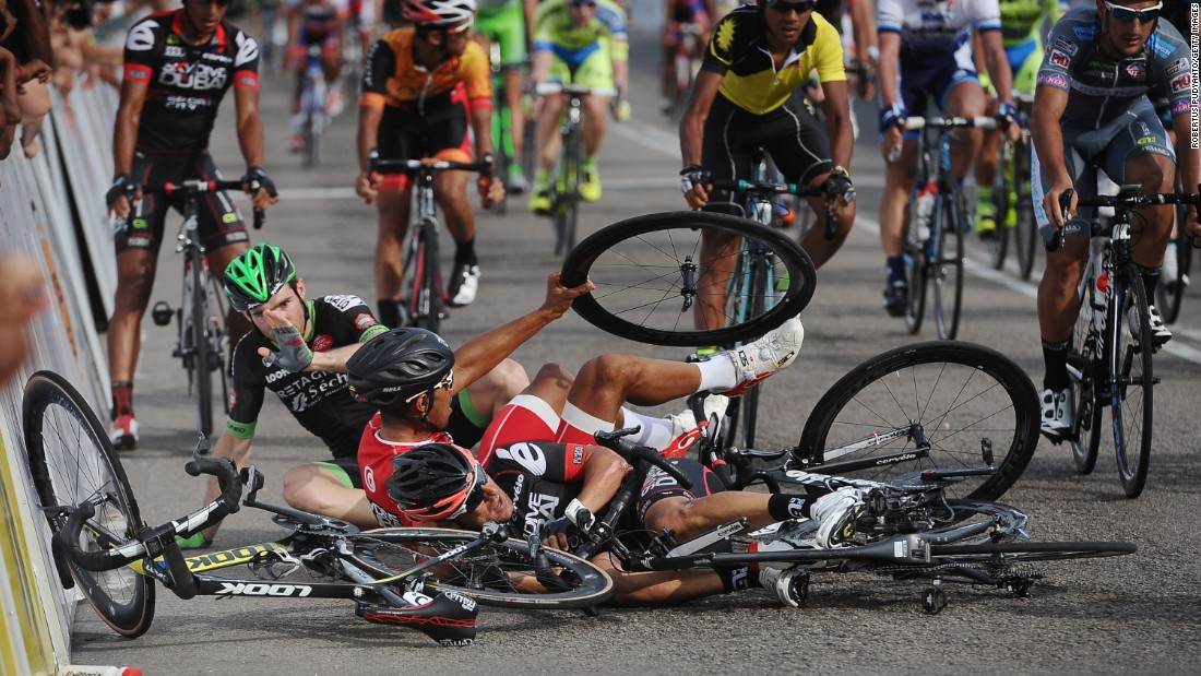 Cyclists crash on Friday, March 13, moments after finishing the sixth stage of the Tour de Langkawi in Kuala Lumpur, Malaysia.