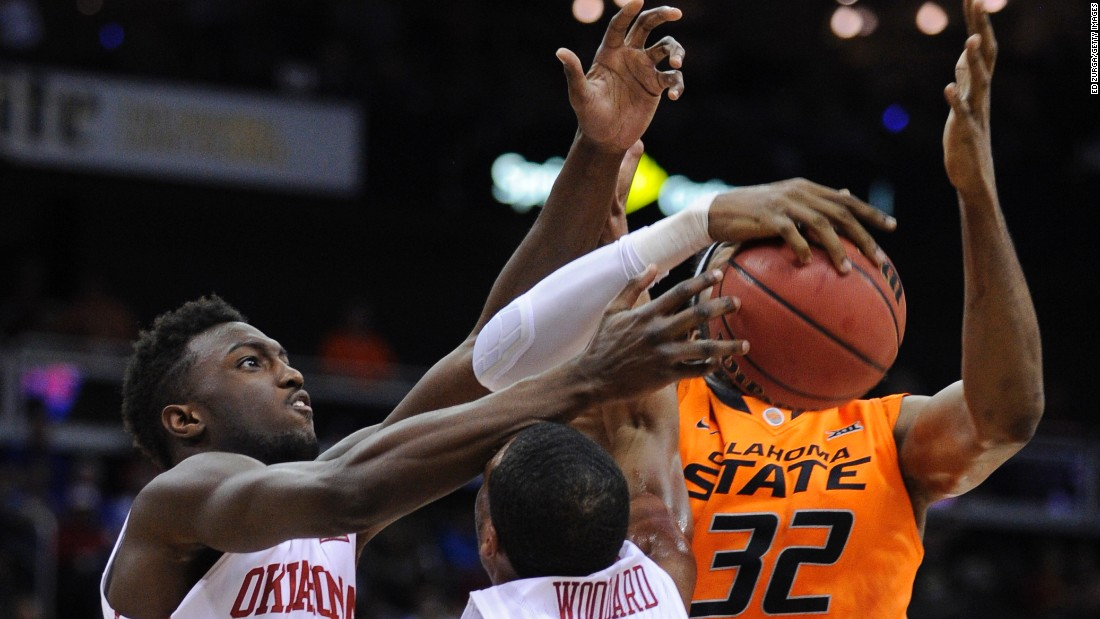 "Oklahoma's Khadeem Lattin and Jordan Woodard compete with Oklahoma State's Anthony Allen Jr. during a Big 12 tournament game Thursday, March 12, in Kansas City, Missouri. <a href=""http://www.cnn.com/2015/03/10/sport/gallery/what-a-shot-0310/index.html"" target=""_blank"">See 34 amazing sports photos from last week</a>"
