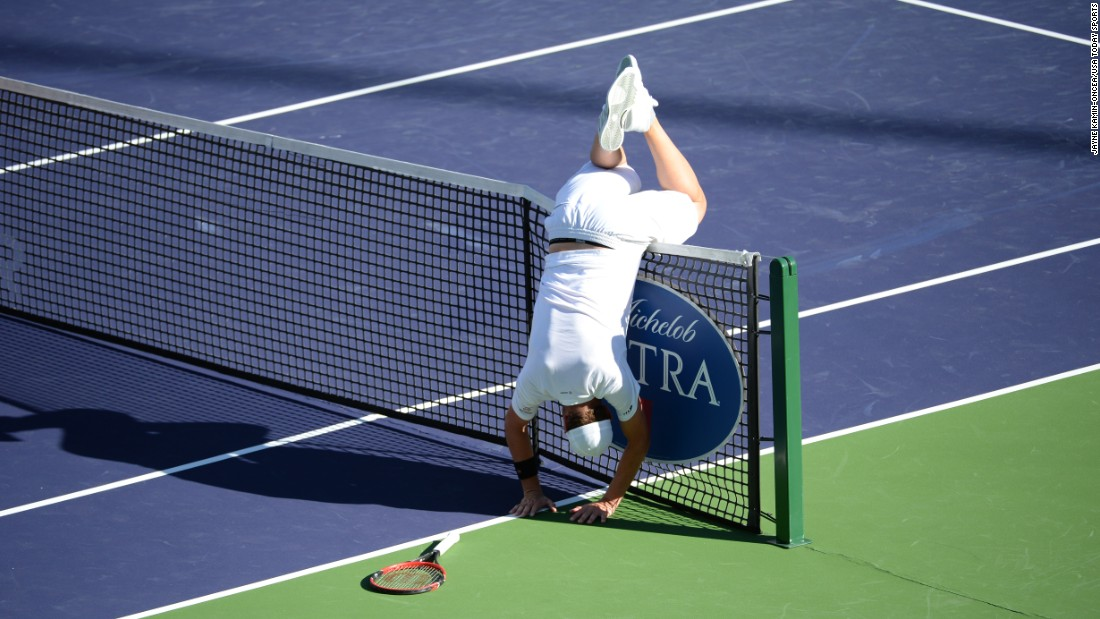 Mardy Fish flips over the net Thursday, March 12, after chasing down a ball during his first-round match at the BNP Paribas Open in Indian Wells, California.