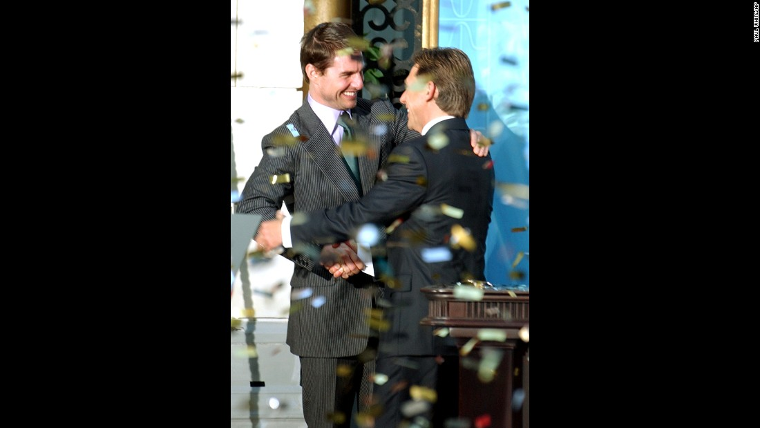 "Confetti rains down as actor Tom Cruise, left, embraces David Miscavige, the leader of the Church of Scientology, at the opening of a new church in Madrid in September 2004. Cruise is one of the world's most prominent Scientologists. ""What I believe in my own life is that it's a search for how I can do things better, whether it's being a better man or a better father or finding ways for myself to improve,""  Cruise told Playboy magazine. ""Individuals have to decide what is true and real for them."""