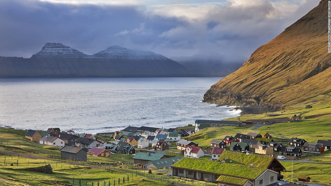 "On the northeast corner of Eysturoy, the village of <a href=""http://www.visitfaroeislands.com/en/what-to-do/gjogv-green-village/"" target=""_blank"">Gjogv</a> is home to fewer than 50 inhabitants. Much attention has gone into preserving the traditional red, white and green Faroese building design."
