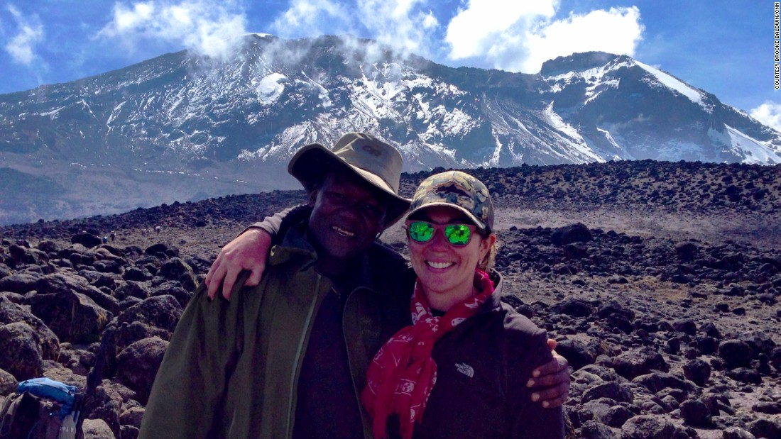 Brooke poses with her group's Kilimanjaro guide, Dismass Mariki.