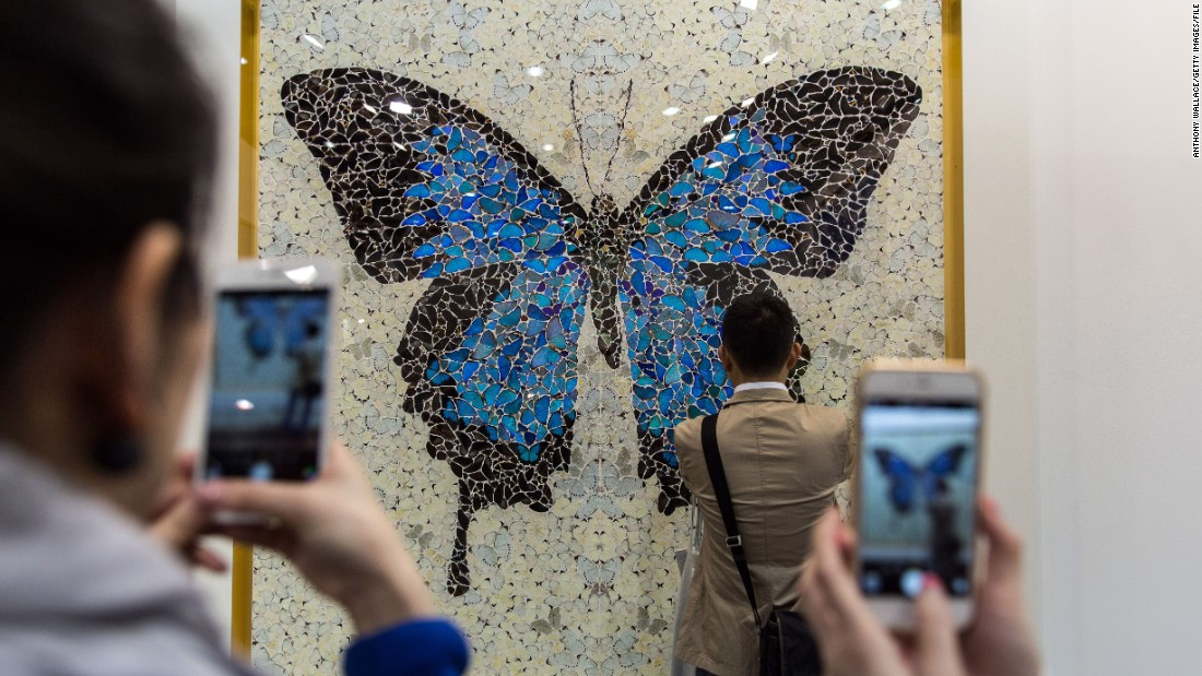 "And sometimes works were even more real than they appeared. Actual butterflies were used in this collage by British artist Damien Hirst, called ""Papilio Ulysses."""