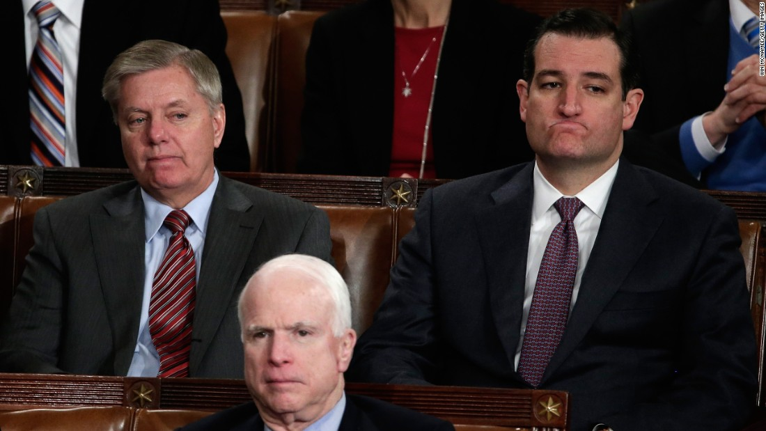 (Left to right) Sen. Lindsey Graham, Sen. John McCain and Cruz listen as President Barack Obama delivers the State of the Union address  on January 28, 2014, in Washington, D.C.