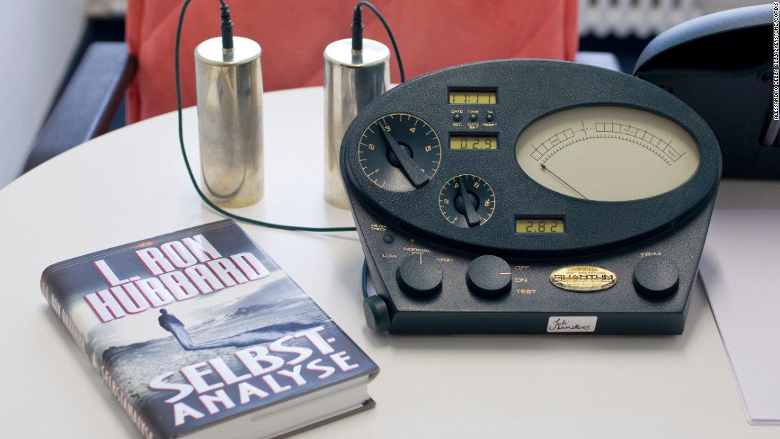 "An E-meter sits next to Hubbard's book ""Self Analysis"" in Zurich, Swizerland, in January 2011."