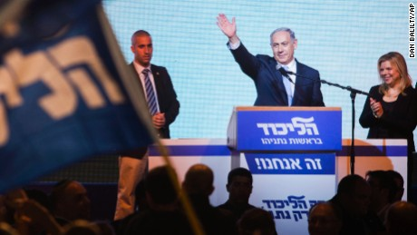Israeli Prime Minister Benjamin Netanyahu greets supporters at the party's election headquarters in Tel Aviv. Wednesday, March 18, 2015. Netanyahu's ruling Likud Party scored a resounding victory in the country's election, final results showed Wednesday, a stunning turnaround after a tight race that had put his lengthy rule in jeopardy.(AP Photo/Dan Balilty/AP)