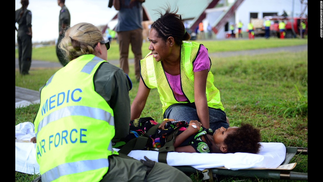 Australian doctors help a young girl on the Vanuatu island of Tanna on Wednesday, March 18.