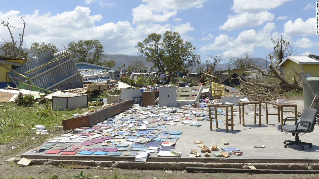 Books recovered from a school are left out to dry in Port Vila on March 18.