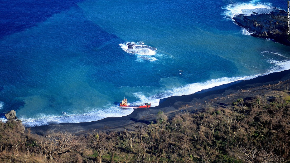A ship sits beached along the shore of Tanna on March 18.