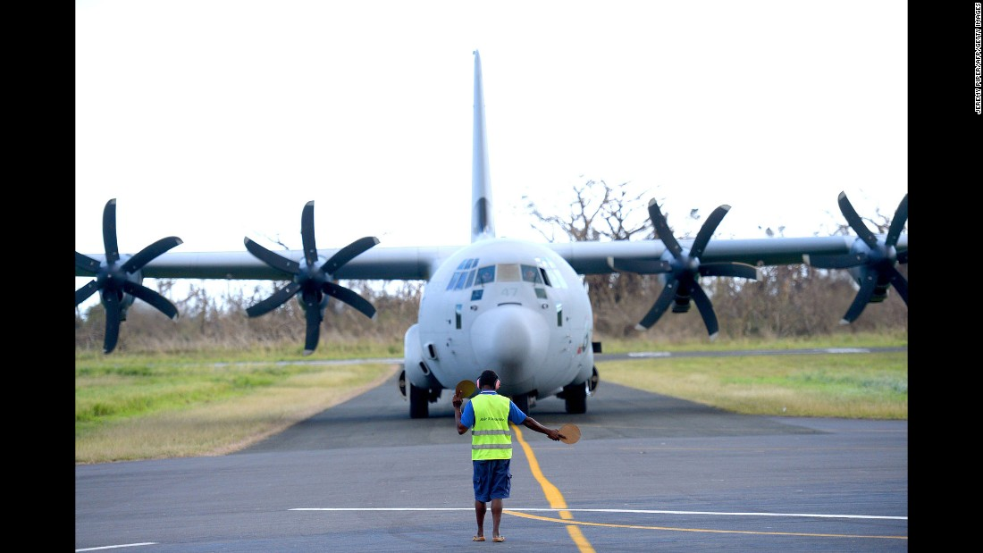An Australian army relief aircraft arrives with supplies at the airport in Tanna on March 18.