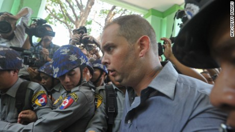 New Zealander Philip Blackwood (C) leaves a court in Yangon on March 17, 2015 after he and two Myanmar colleagues were sentenced to two and a half years in jail over using a Buddha image to promote a cheap drinks night.