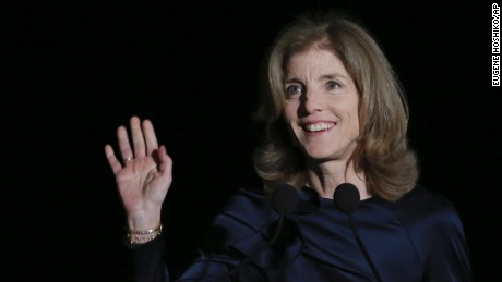 U.S. Ambassador to Japan Caroline Kennedy waves before she delivers opening remarks during JFK International Symposium at Waseda University in Tokyo Wednesday, March 18, 2015. Japanese police are investigating phone calls threatening to kill U.S. Ambassador Kennedy. (AP Photo/Eugene Hoshiko/AP)
