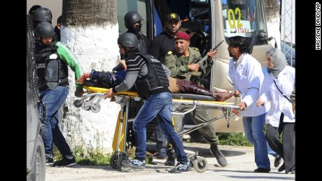 A victim is being evacuated by rescue workers outside the Bardo museum in Tunis, Wednesday, March 18, 2015 in Tunis, Tunisia. Gunmen opened fire at a leading museum in Tunisia's capital, killing 19 people  including 17 tourists, the Tunisian Prime Minister said. A later raid by security forces left two gunmen and one security officer dead but ended the standoff, Tunisian authorities said. (AP Photo/Hassene Dridi)