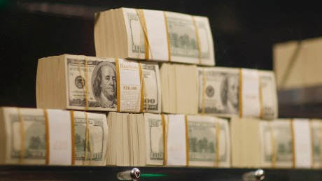 Stacks of money are seen in what is being called a first-of-its-kind exhibit of five million dollars in cash at the Seminole Hard Rock Hotel & Casino on March 18, 2009 in Hollywood, Florida. The display consists of $100 bills encased in a 1,300-pound, custom-made $90,000 bullet-resistant Lexan showcase. (Photo by Joe Raedle/Getty Images)