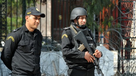 Tunisian security forces stand guard outside the National Bardo Museum in Tunis on March 19, 2015, in the aftermath of an attack on foreign tourists. Tunisia's president promised to wage a 'merciless war against terrorism' after gunmen killed at least 17 foreign tourists and two Tunisians in a daylight attack in the birthplace of the Arab Spring.