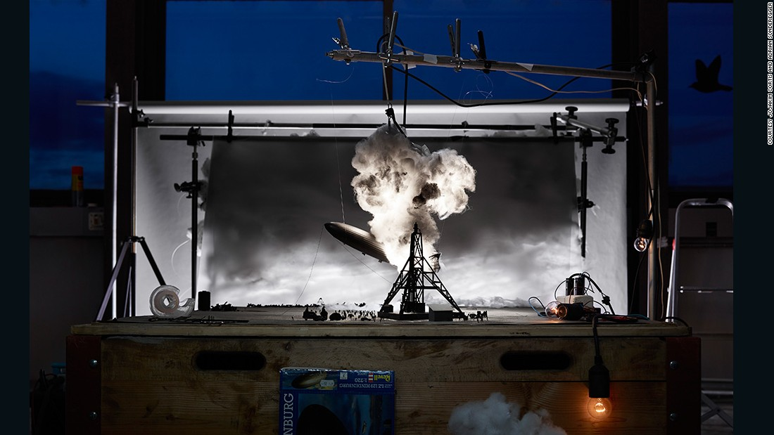 At first glance it could appear like an elaborate movie set. In fact, it's a miniature model of photographer Sam Shere's well-known 1937 image of the Hindenburg disaster. The eerily realistic work is one of around a dozen famous pictures recreated by Swiss artists Jojakim Cortis and Adrian Sonderegger.
