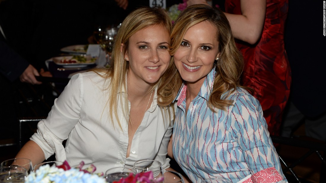 Country singer Chely Wright, right, and wife Lauren Blitzer-Wright welcomed twin boys in May 2013.