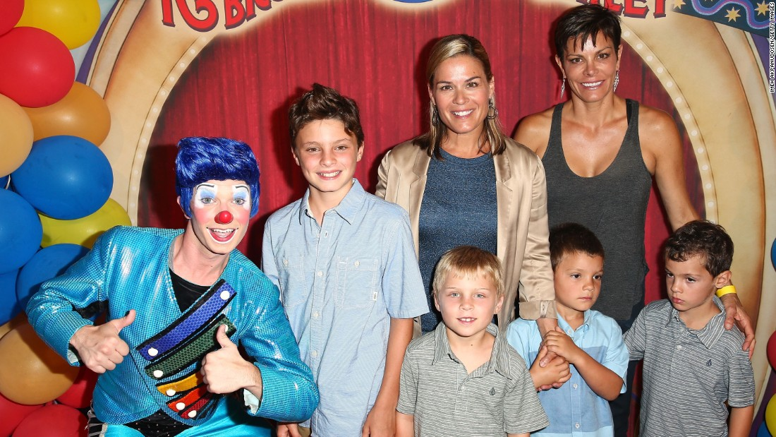 "Celebrity chef Cat Cora, center, and wife Jennifer Cora are shown here with their four sons at the 2014 premiere of Ringling Bros. and Barnum & Bailey's ""Legends"" in Los Angeles."