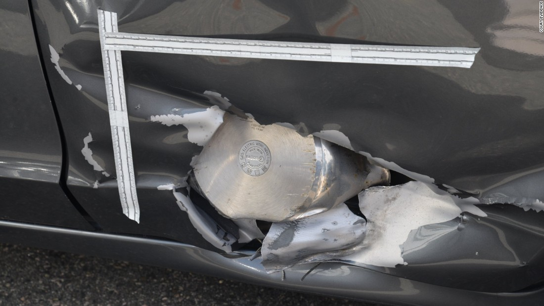 A pressure cooker was embedded in the side of a resident's Honda during the Watertown shootout.