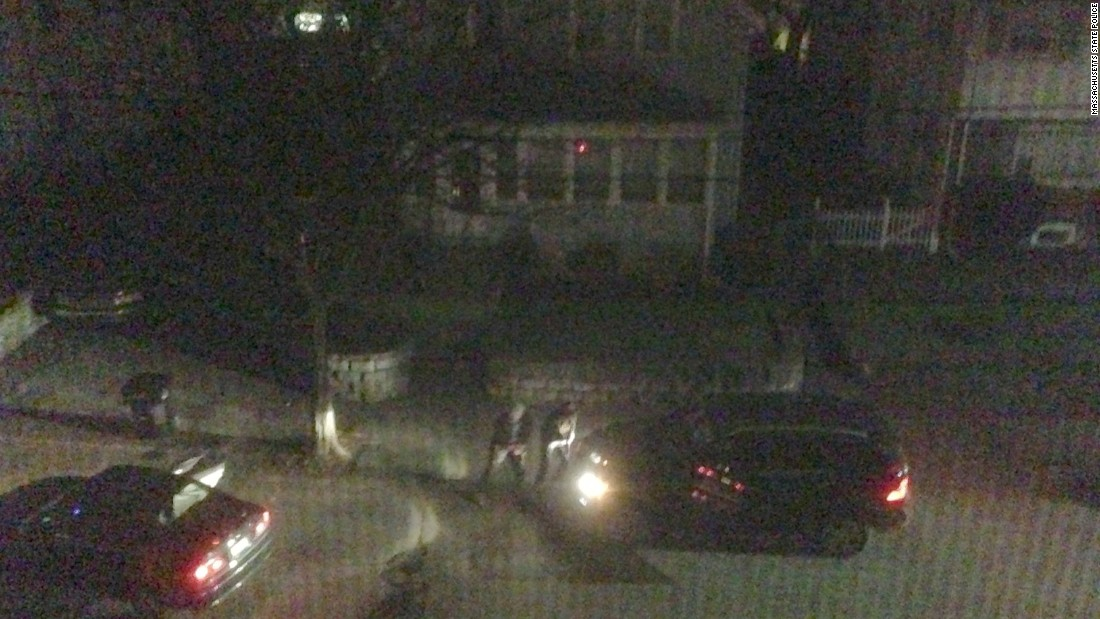 Photos of the Watertown shootout were entered into evidence. Neighbors came to their windows and then retreated. One grabbed his infant son and headed toward the back of his house with his wife. Another grabbed a camera and took photographs from an upstairs window.