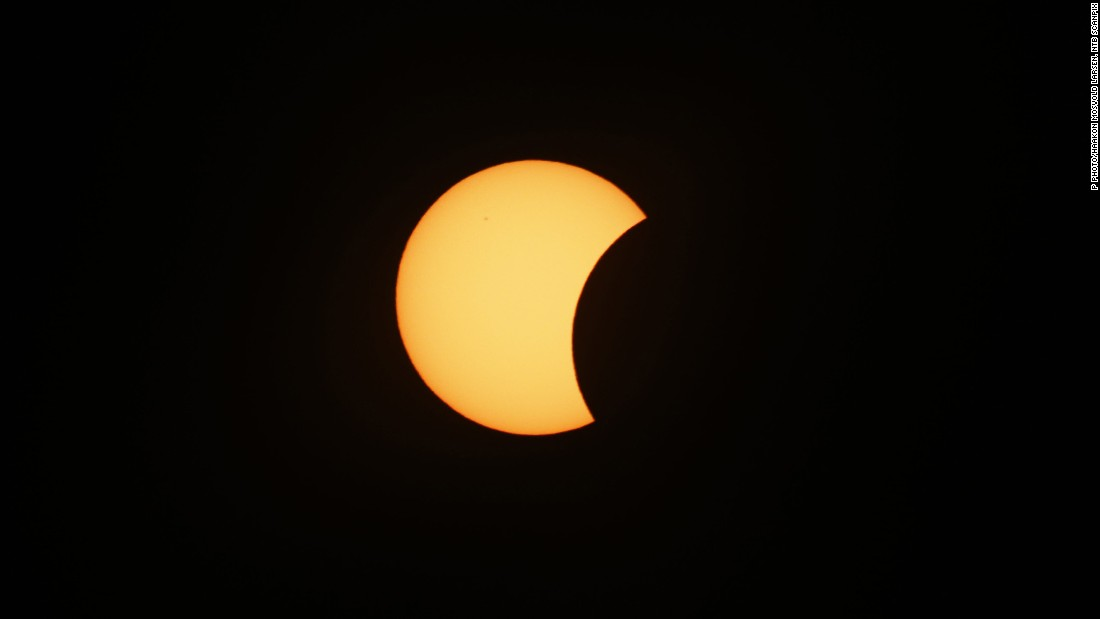 An eclipse is darkening parts of Europe on Friday in a rare solar event that won't be repeated for more than a decade.