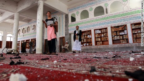Yemeni armed men inspect the damage following a bomb explosion at the Badr mosque in southern Sanaa on March 20, 2015. Triple suicide bombings killed at least 55 people at mosques in the Yemeni capital attended by Shiite Huthi militiamen who have seized control of the city. AFP PHOTO / MOHAMMED HUWAIS (Photo credit should read MOHAMMED HUWAIS/AFP/Getty Images)