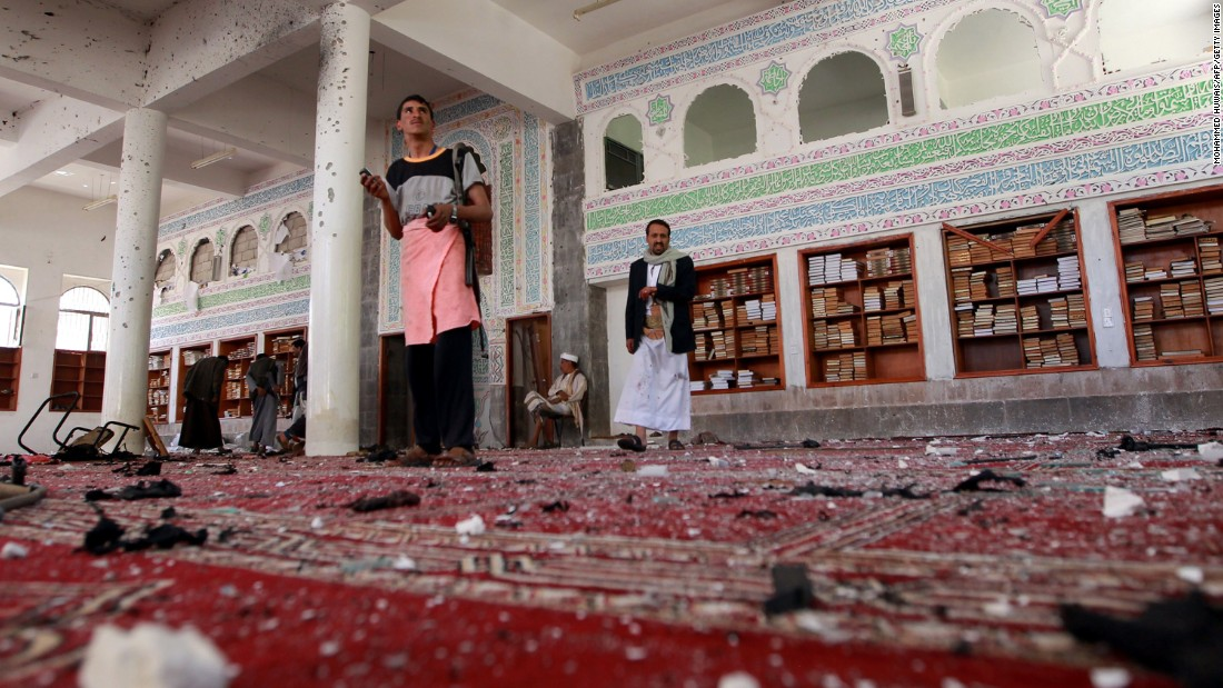 Armed men inspect damage after an explosion at Al Badr mosque in Sanaa, Yemen, on Friday, March 20. Deadly explosions in Yemen's capital rocked two mosques serving a minority Muslim group that recently conquered the city. The mosques serve members of the Zaidi sect of Shiite Islam, which is followed by the Houthi rebels who recently took control of the capital.